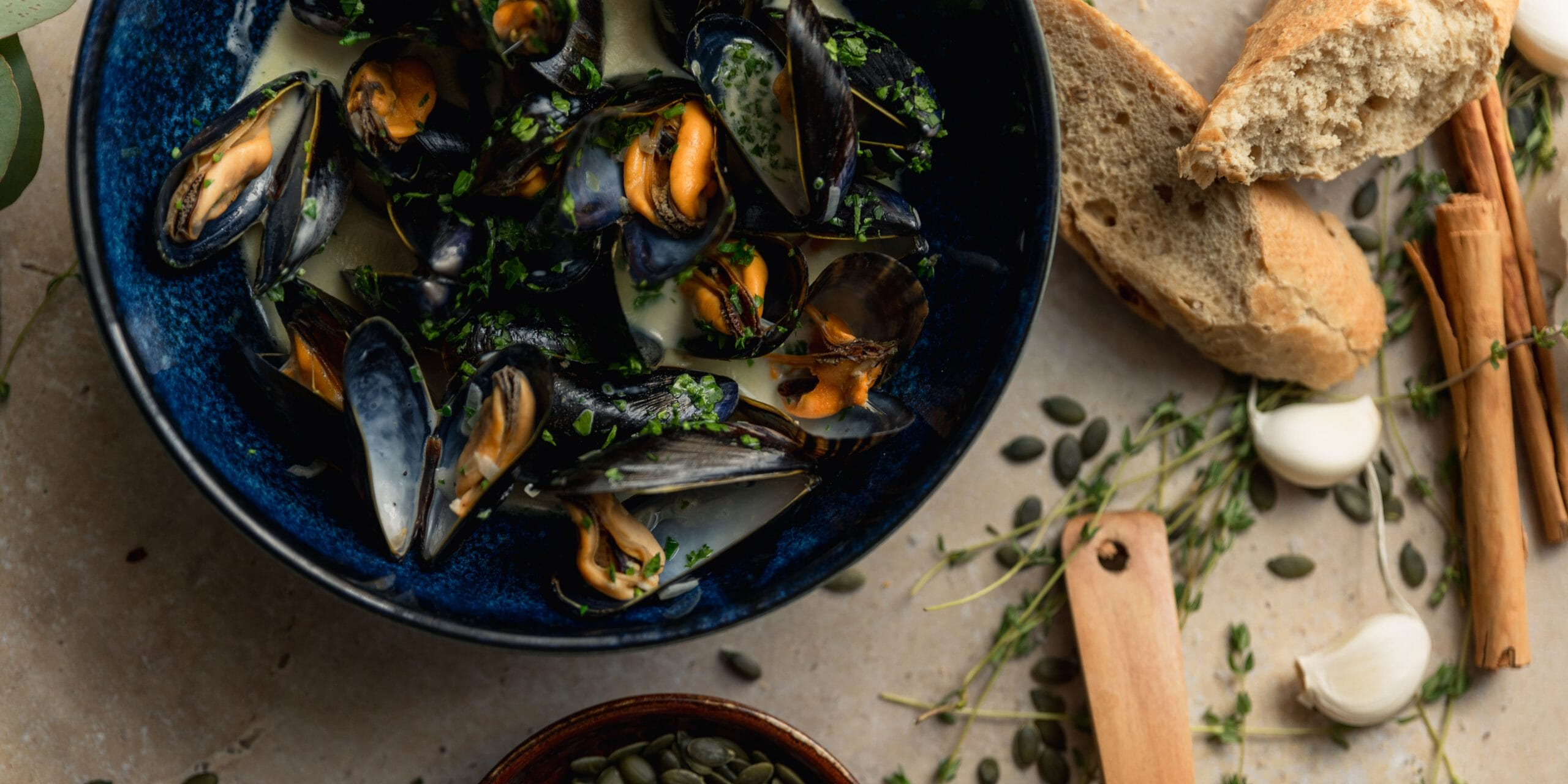 Moule Mariniere with fresh-baked bread  - Kindred menu